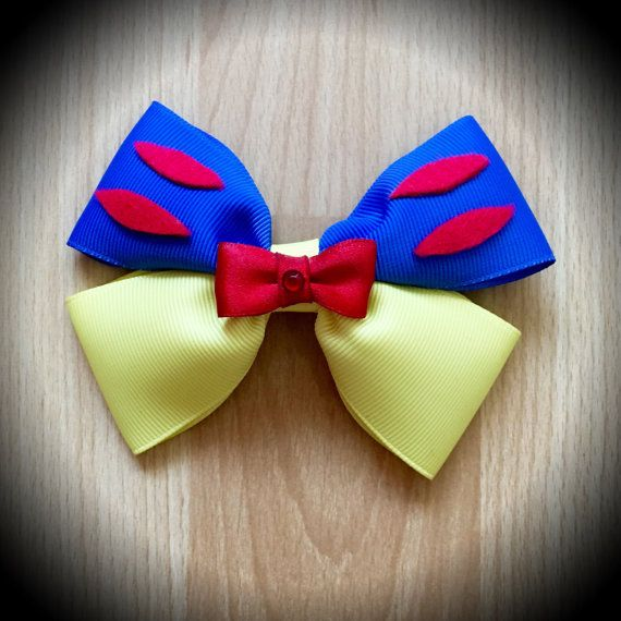 Snow White Character Inspired Disney Princess Hair Bow Blue and YellowGrosgrain Ribbon Decorated with Red Felt Accents and Red Satin Ribbon Mini Bow Centrepiece with Rhinestone. Mounted on an alligator clip. I can do custom bows, just let me know if youd like something specific. Price is for single bow.