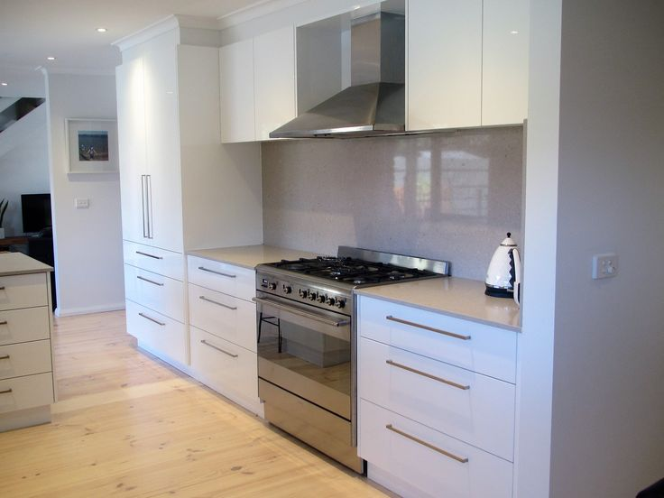 Everything in its Place - Contemporary white and gray kitchen, clam shell Caesar Stone bench and splash back, lime washed timber floors, modern white and gray kitchen, modern white kitchen, contemporary white kitchen, gray bench, grey bench, free standing oven, smeg oven, canopy rangehood