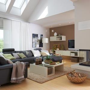 In großzügigen Räumen bringt ein Farbton wie Macchiato Nähe. Der Farbton greift die Töne des Sofas, Teppichs und der Deko wieder auf.