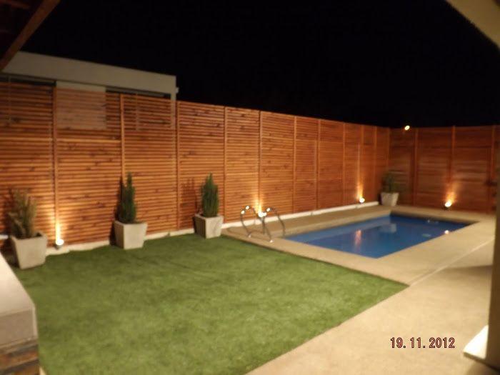 Quincho altos de huechuraba terraza porche jardin for Disenos de quinchos con piscinas