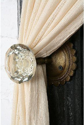 use glass doorknobs as curtain holders
