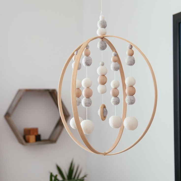 Modern Orb Mobile No. 5, Sproutling Co. | Freshly Picked Baby Moccasins, #FPMarketplace, delicate arching wood, soft gray and ivory wool poms, geometric wooden beads, handmade with raw materials, gender neutral