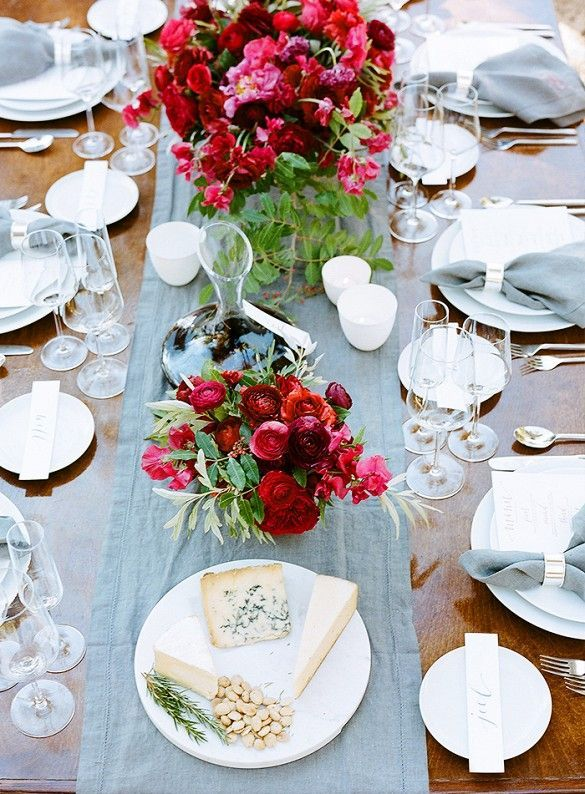 Soft and Elegant table with clear glassware and soft blue linen.
