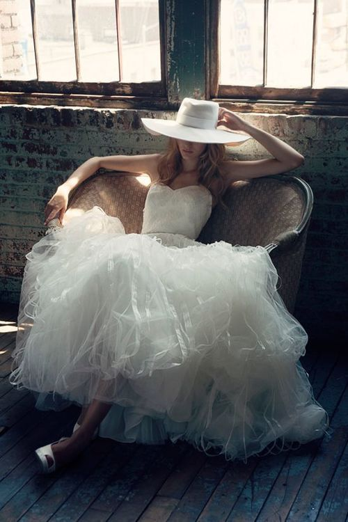 She wore a cloud of tulle with silk ribbons as if she was waiting for her knight to sweep her off her feet.