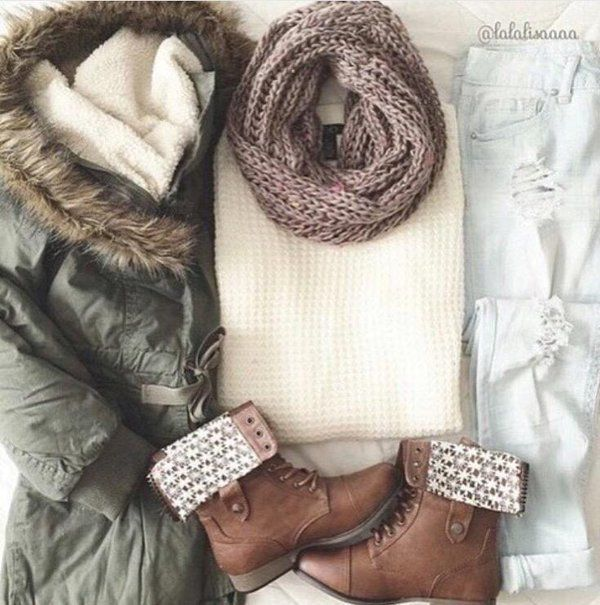 Khaki Jacket with Fluffy Hood, White-Grey Knitted Sweater, Beige Scarf, White Ripped Jeans, and Some Stylish Buckled Boots