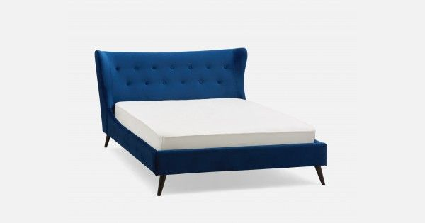 With its slim, slightly whimsical silhouette, the Alice bed is upholstered in easy-clean polyester and has its curves in all the right places. But this bed is not just  sexy – it also has a lightly padded, tufted wingback headboard and angled, painted walnut legs, so you can rest assured that it's comfortable and solid, too.