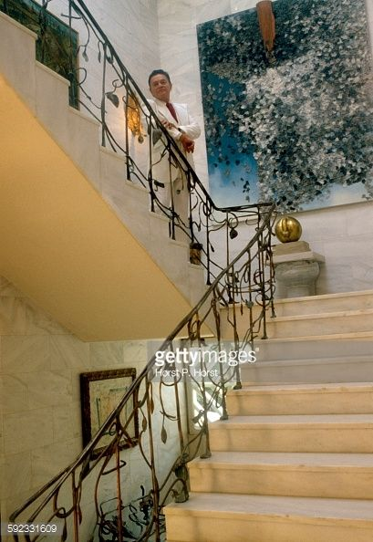 http://media.gettyimages.com/photos/art-collector-alexander-iolas-wearing-a-white-suit-and-standing-on-picture-id592331609?s=594x594