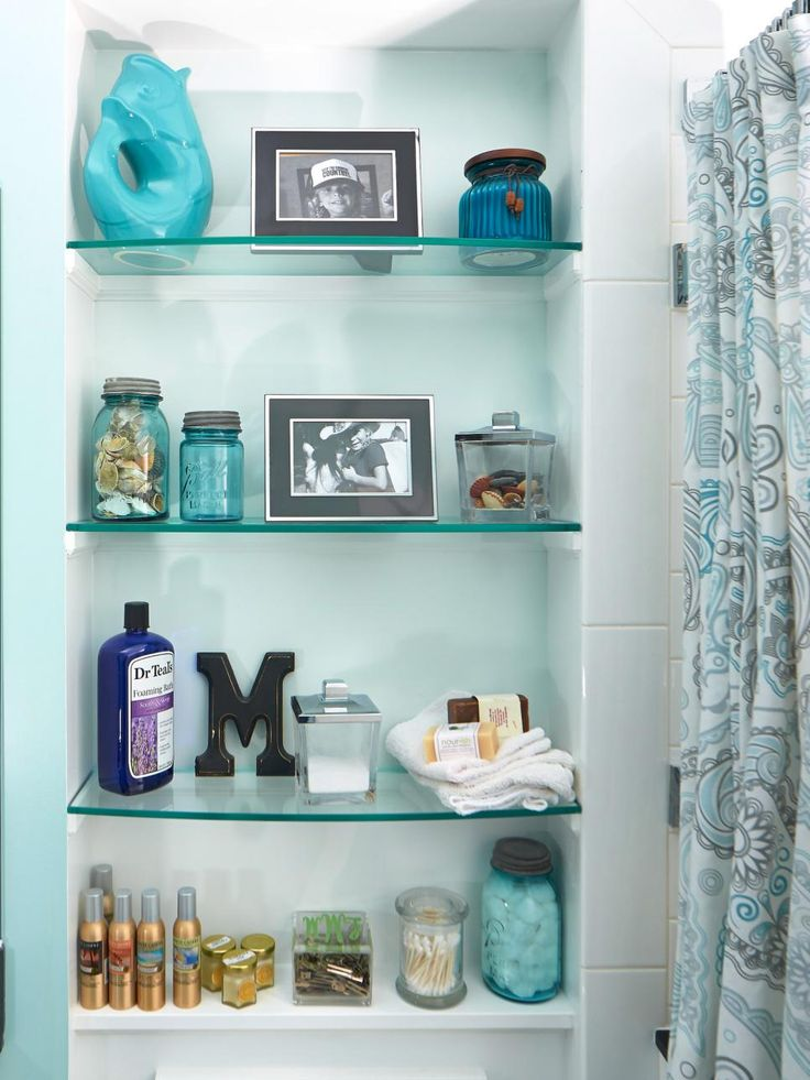 Solution: For this bathroom by Criner Remodeling, a niche behind the toilet with built-in glass shelves creates a much-needed home for grooming essentials and framed photos. This keeps the products within easy reach, and the photos help personalize the space.