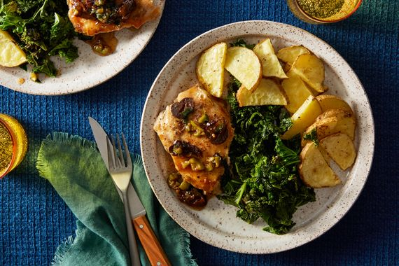 A quick version of the classic savory-sweet sauce (made with green olives and prunes) helps to achieve the same irresistible flavors of slow-cooked chicken Marbella. On the side, we're roasting Yukon Gold potatoes with fresh oregano for an aromatic lift. (Chefs, your kale may be green curly, dark green lacinato, or red.)