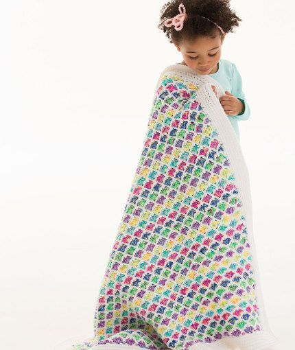 Chasing Rainbows Blanket Free Crochet Pattern in Red Heart Yarns by Marly Bird. What a fabulous scallop stitch afghan pattern and those colours are perfect for a girls bedroom! A great little crochet tutorial.