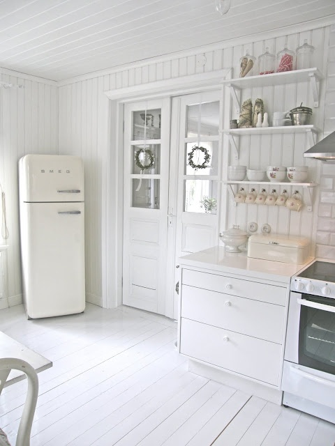 White kitchen. Simple but beautifully light & bright.