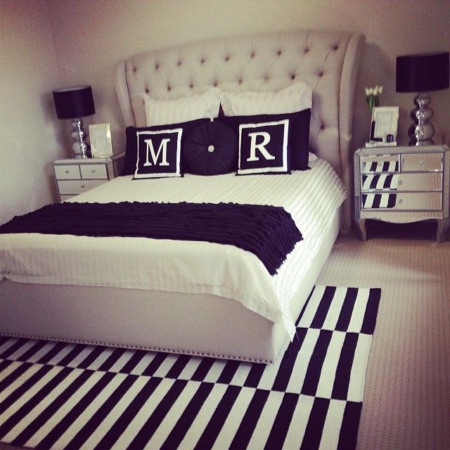 tufted, black & white, stripes, mirrored furniture, lamps.