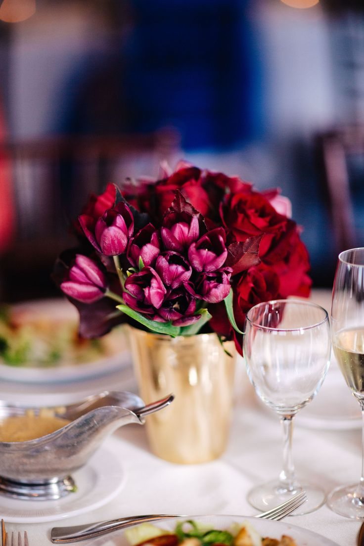 modern and monochromatic bridesmaid bouquet of red amaryllis, burgundy mini…