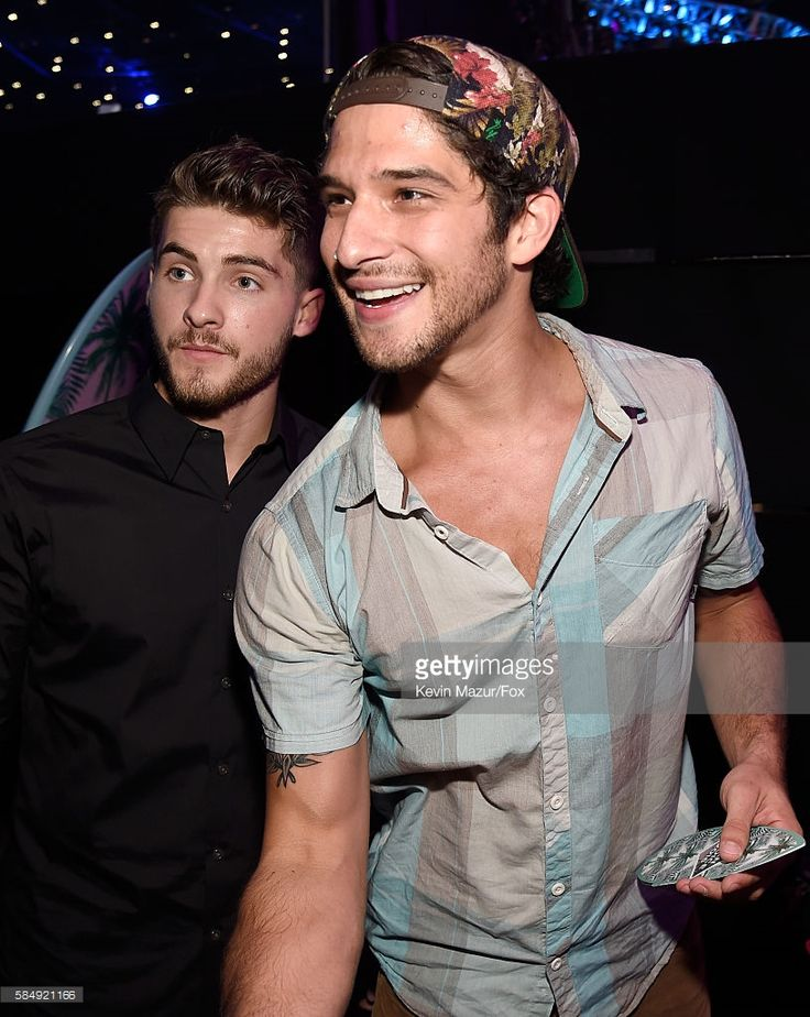 Actors Cody Christian and Tyler Posey attend the Teen Choice Awards 2016 at The Forum on July 31, 2016 in Inglewood, California.