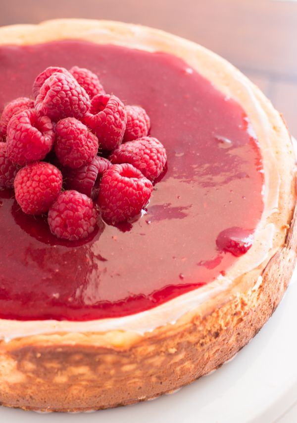 Greek Yogurt New York Cheesecake with brown sugar berry sauce on ohsweetbasil.com