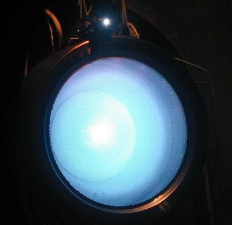 NASA Evolutionary Xenon Thruster (NEXT) in operation. NASA's new solar-electric propulsion thruster uses xenon ions for propulsion. The thruster can provide higher spacecraft top speeds than any other rocket currently available.
