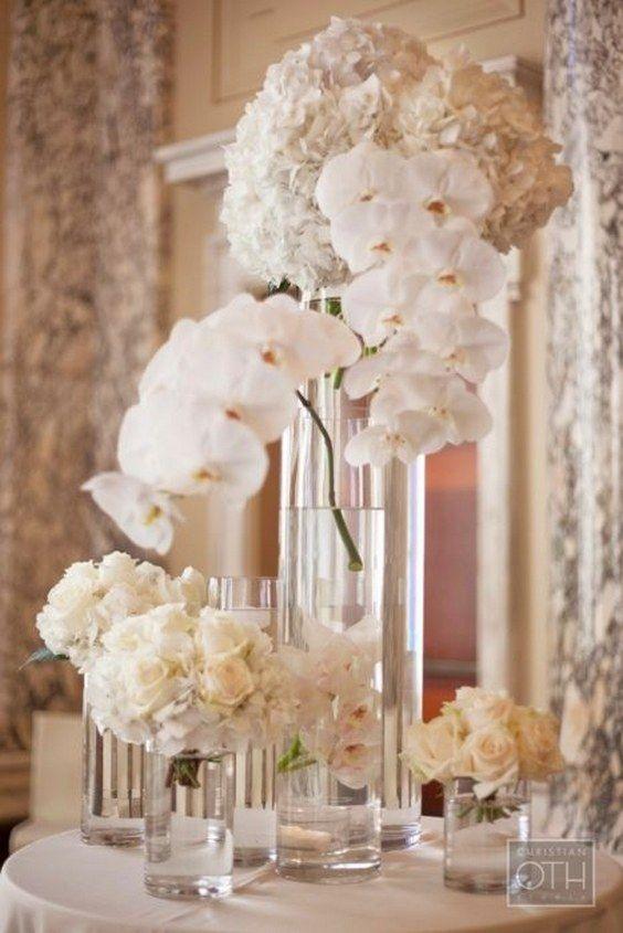white wedding flower ideas / http://www.himisspuff.com/simple-elegant-all-white-wedding-color-ideas/12/cen