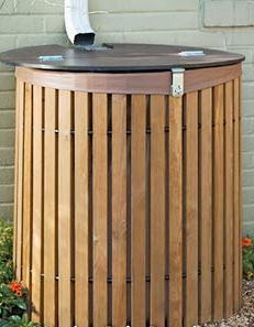 Rain barrel covered by wooden slats....this would actually be an easy DIY