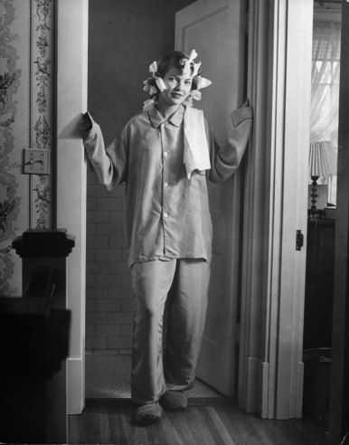 Nina Leen—Time & Life Pictures/Getty Images Mens pajamas are worn at night. Hair is curled with rags, not bobby pins.