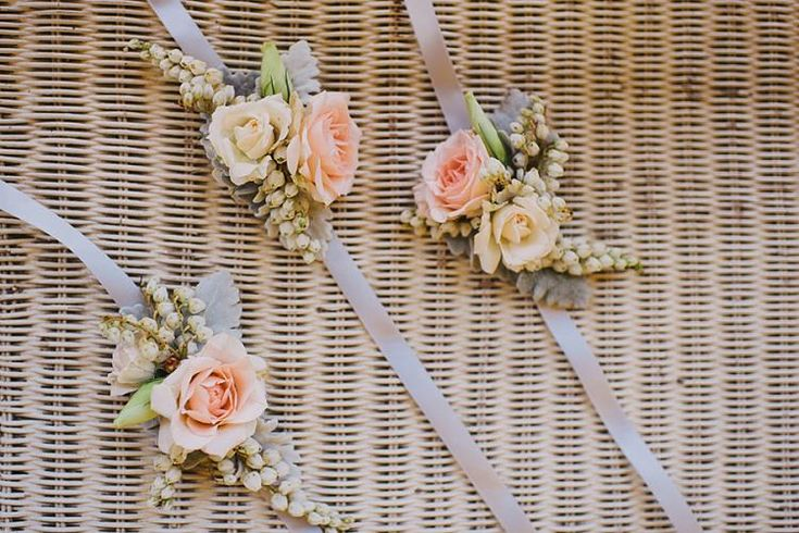 These are a very pretty alternative to bouquets - corsage on ribbon. Also ideal for mothers of the bride & groom instead of the traditional pin method, especially if they are wearing very fine material.