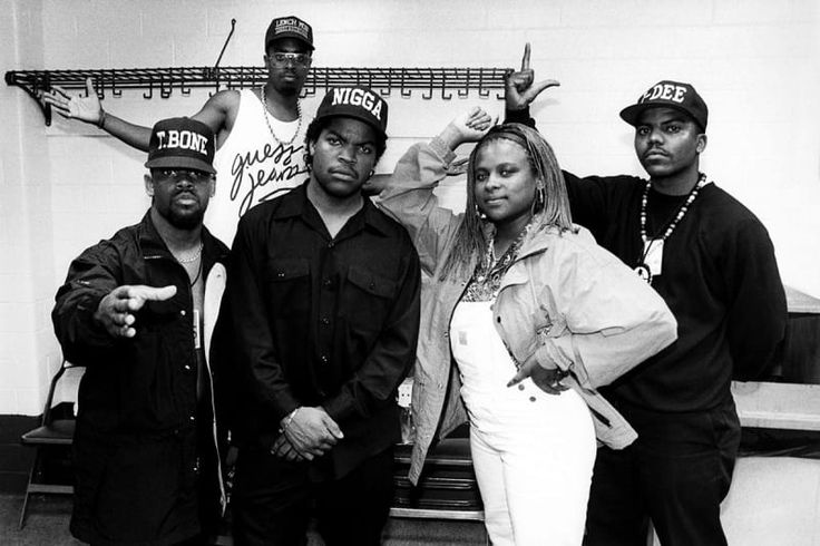 Ice Cube poses with the Lench Mob (T-Bone, Sir Jinx, Yo-Yo, and J-Dee) backstage at The Arena in St. Louis in 1990.