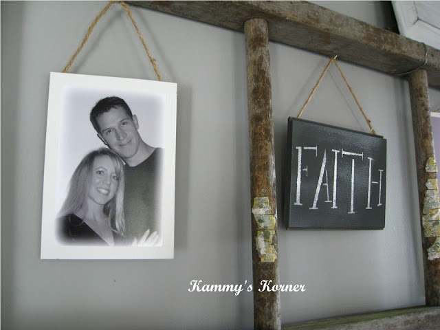A branch ladder with twine hung pictures... love this!! Kammy's Korner