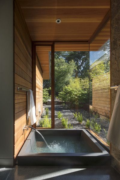 An onsen, or Japanese soaking tub, with a private garden abuts the master suite.