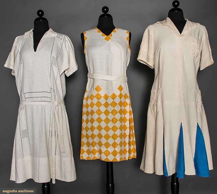 THREE WHITE LINEN DAY DRESSES, 1920s Possibly for sports wear: 1 sleeveless, goldenrod yellow triangle appliques, diamond print on skirt, 2 w/ short sleeves: 1 w/ 3 embroidered patch pockets & alternating blue linen skirt gores & 1 w/ drawn thread work; t/w 1 eyelet linen day dress