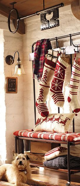 Hang stockings along the stage sides, under the garland/candles...