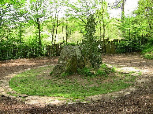 Merlin's Tomb is a neolithic megalith in Paimpont Forest near the city of Rennes in Brittany, France. The Bretons tell many legends of King Arthur and his great magician, Merlin. It is in this forest, at the fountain of Barenton, that Merlin first met and fell in love with the fairy Viviane, the Lady of the Lake. It is also stated that Merlin's tomb can be found in the heart of the forest, hiding the 'prison of air' in which Viviane incarcerated him to prevent his return to Arthur's court.