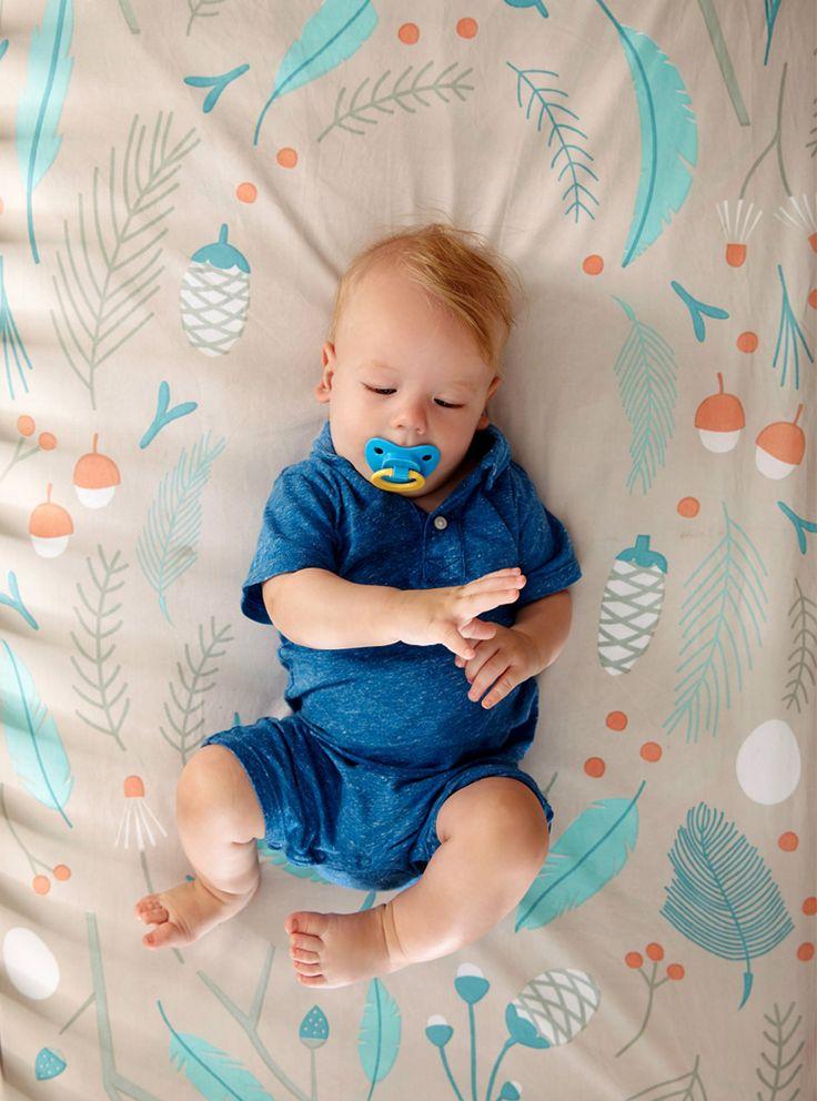 Land of Nod, Well Nested Crib Sheet in Blue Nest; photograph by Dane Tashima