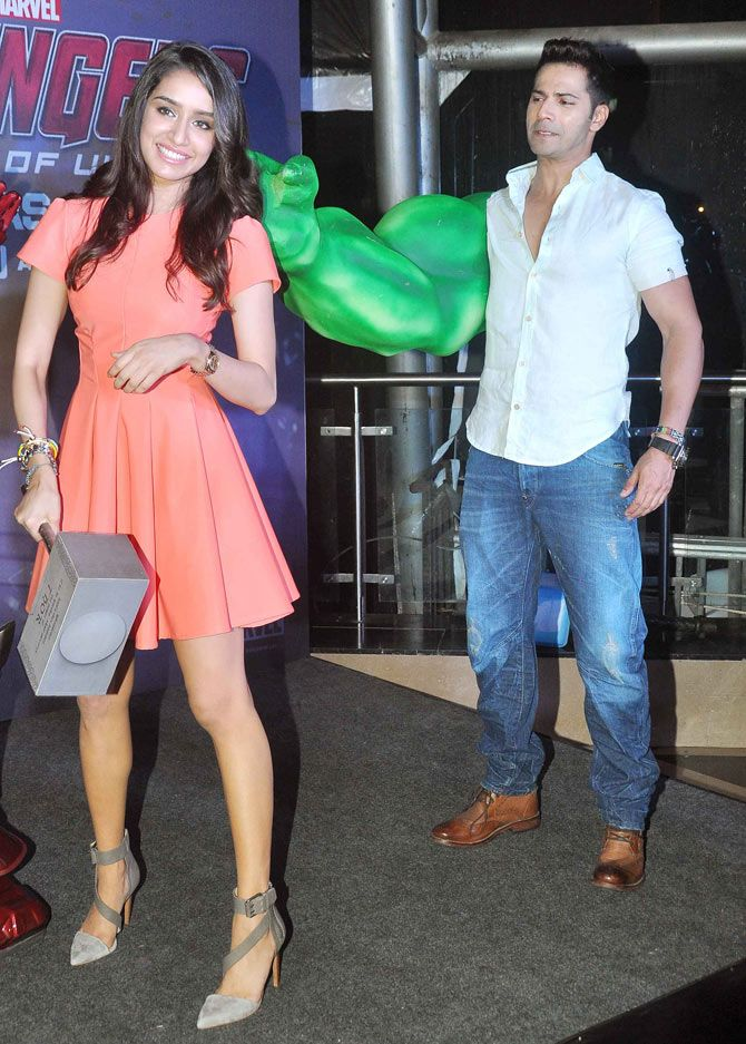 Varun Dhawan, wearing an oversized Incredible Hulk arm, jokes around with Shraddha Kapoor at the screening of 'Avengers: Age of Ultron'