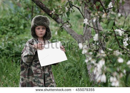 sad boy in uniform with white paper