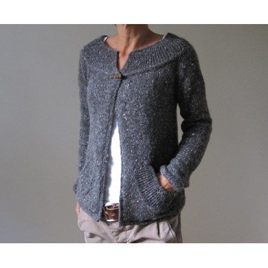 This cozy cardigan is worked from the top down, and requires only a minimal amount of seaming. The collar is worked first in sideways garter stitch and then the stitches for the yoke are picked up along the long edge of the collar. The yoke, sleeves and body are then worked down in one piece. The pattern includes detailed instructions for the pockets, which are not complicated! Also included are instructions for i-cord edges, but you can work garter edges if you prefer to avoid i-cording. I…