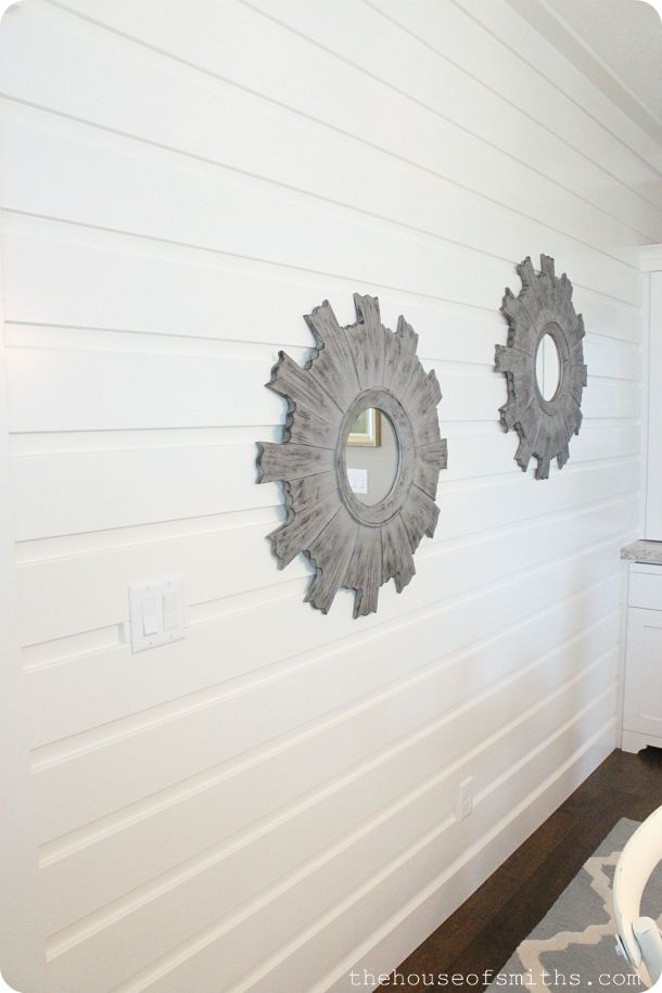 In the dining room Brian decided to add this simple wall treatment to our space. I LOVE it, and will definitely be using the same concept in our home somewhere in the future. It's just plain ol' MDF boards, spaced out about an inch and a half from each other, and then painted all semi-gloss white. A spin off of regular board and batten and planking... Genius!