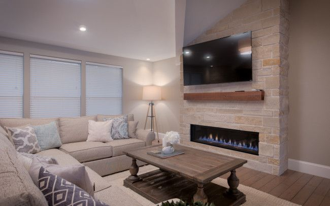 Natural gas insert in stone accent wall by HighCraft Builders.