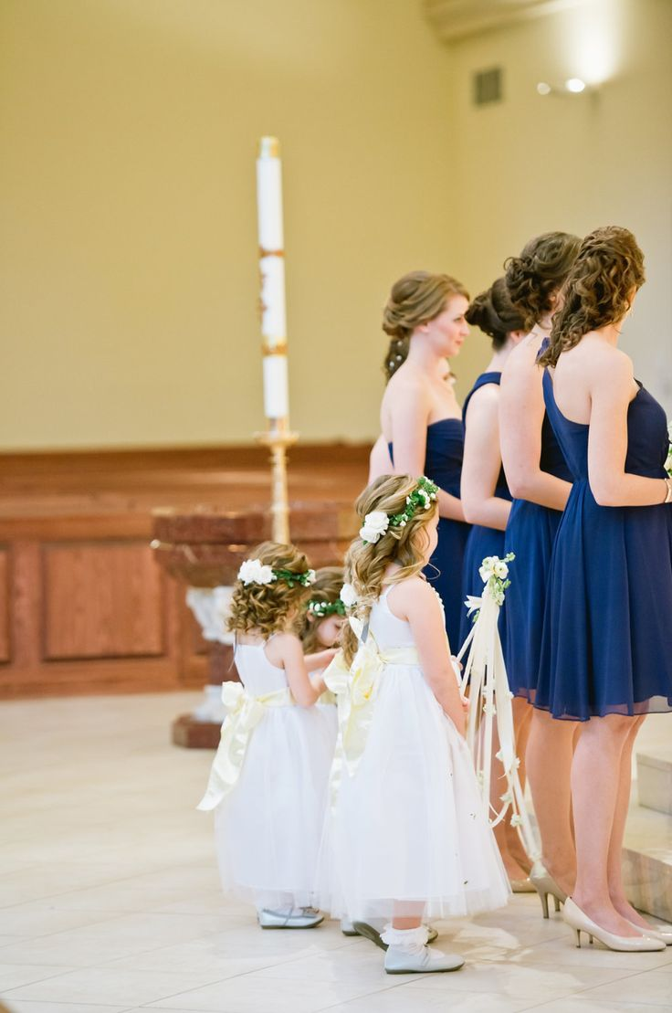 flower girls with their wands and crowns