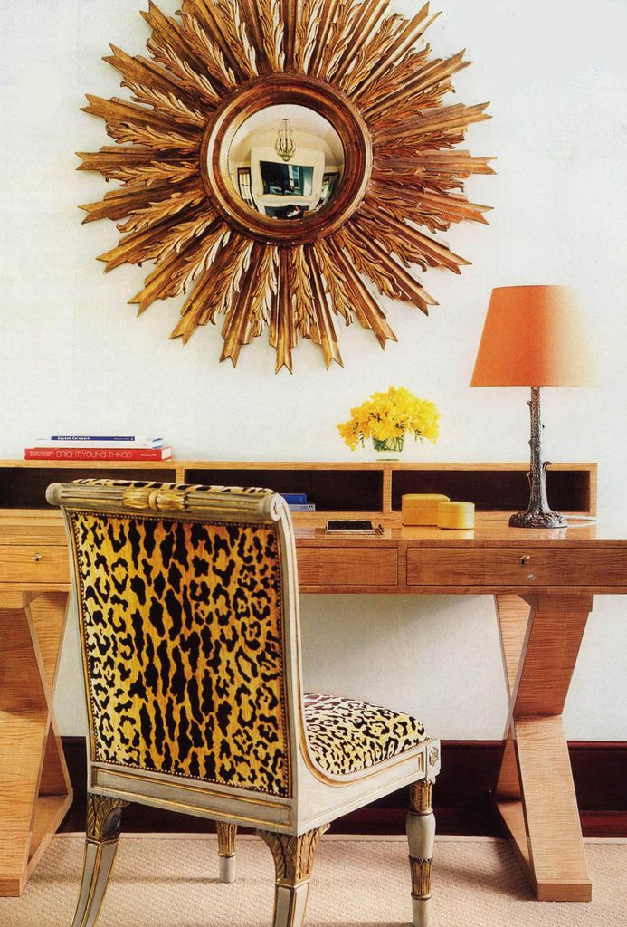 This office has so much personality: sunburst mirror, leopard chair & orange lamp