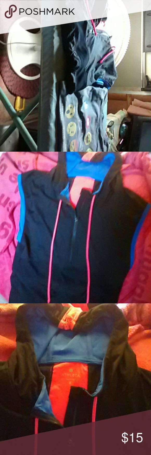 2 top bundle. Size  Small For sale, two wonderful tops. The first one is a athletic top with a hood. the colors are black electric blue and a bright Peach.By Athleta. Top number 2 is a grey shirt with different emojis talking about soccer. Both in excellent preowned condition. Please note that we do have pets and my husband is a smoker. Ask any questions you may have. Have a fantastic day. Tops Sweatshirts & Hoodies