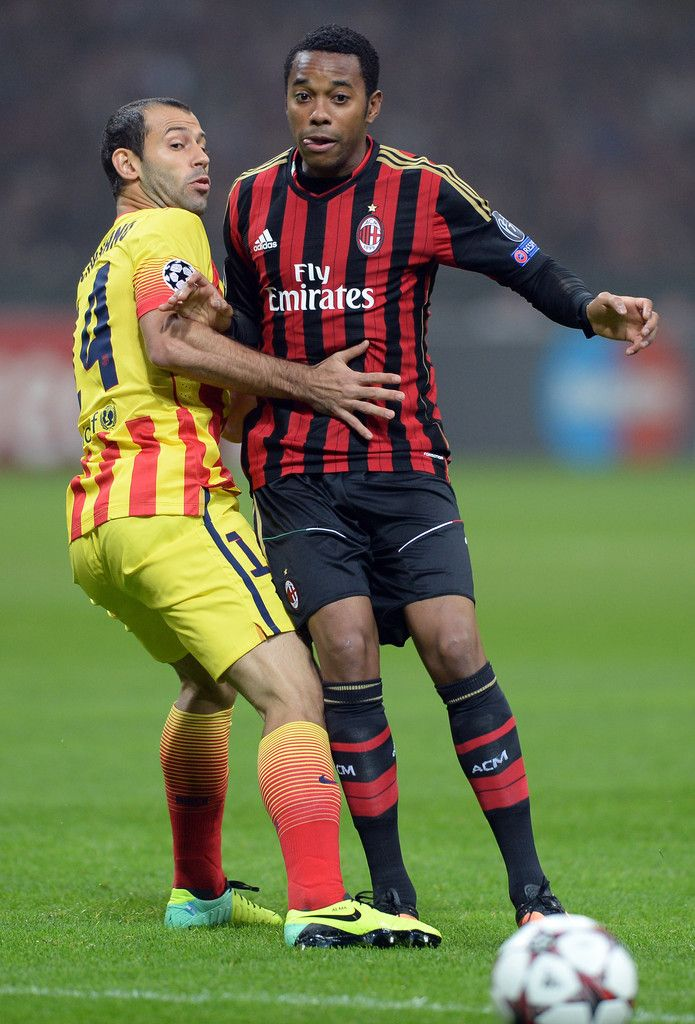 Robinho and Javier Mascherano compete for the ball during the UEFA Champions League group H match between AC Milan and FC Barcelona at Stadio Giuseppe Meazza on October 22, 2013 in Milan, Italy.