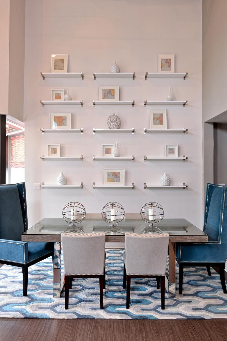 Blue Dining Area With Wall Of Small Shelves Framed Art