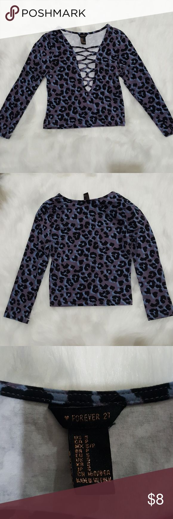 Cute Animal Print Crop Top Size Small Forever 21 crop top in excellent condition in a size small. Would be excellent to pair with a black leather moto jacket and jeans, or even a black skirt. Forever 21 Tops Crop Tops