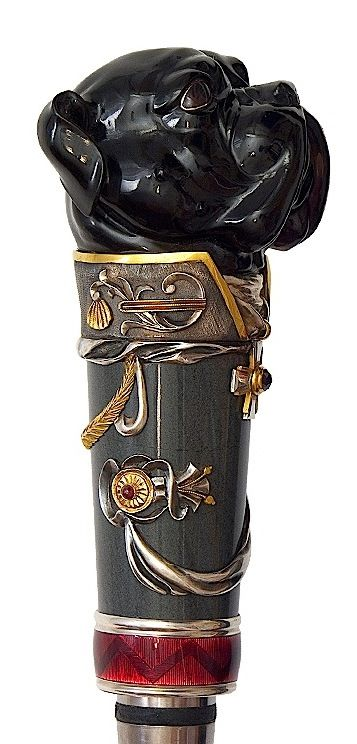 """Walking stick """"General"""" with cylindrical shape which narrow to the tip with stone handle and backpiece and also with blade hidden inside. Walking stick is made of ebony with silver framings covered with red enamel. The tip is made of titanium and decorated with belt of white topazes."""