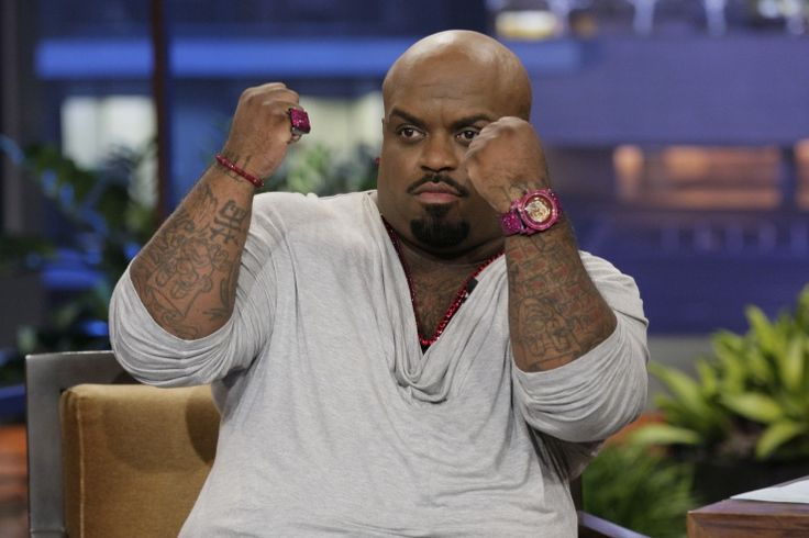 "Show me what you're icing with. Cee Lo Green shows off his hot-pink bling during an appearance on ""The Tonight Show With Jay Leno"" on Sept. 25 in Burbank, Calif."