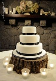 Wedding cake, white fondant, black satin ribbon, stump cake stand