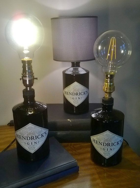 Made from recycled Hendricks Gin Bottles these Table Lamps can be altered to suit your individual style or taste with choice of shade patterns and colours or left without a shade with an Edison-style LED Energy-Efficient Coil Lightbulb for a unique stand-out item. Items without a Shade can be finished with Brass or Silver Fittings and come with standard bayonet fitting (B22). Those with a shade are fitted with a small Edison screw cap (E14) Item without Shade stands at 375mm Item with…