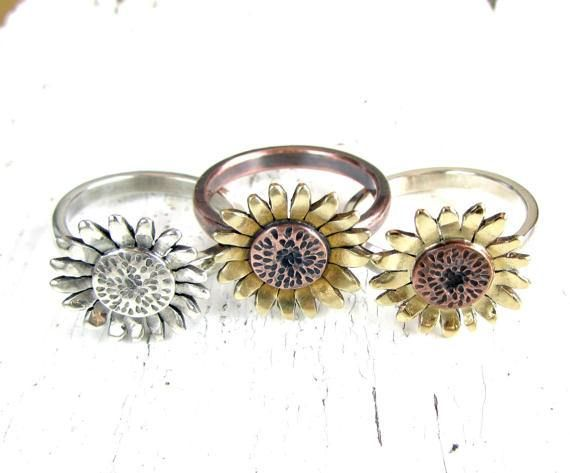 I use a jewelers saw to cut the shape of the sunflower which I soldered onto a half-round band. The center of the flower is stamped. I sanded by hand for smooth edges. The ring is antiqued to add contrast for the metals. You can choose from antiqued copper and brass, antiqued sterling silver, and copper and brass flower with sterling silver band. Sunflower is 5/8 (1,6cm) in diameter. I can custom created one for you in your requested size. Please allow me about 1 week to completely han...
