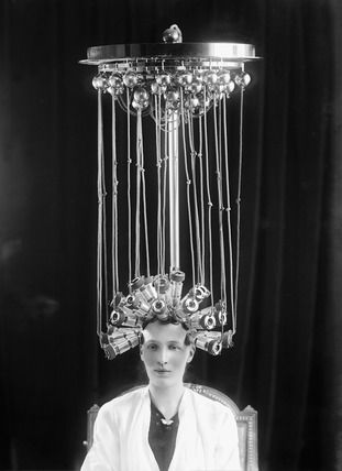 Alexander Bassano Studios -- Woman modeling a hairstyle for the hairdresser Eugene Ltd: 1923 --  Museum of London Prints