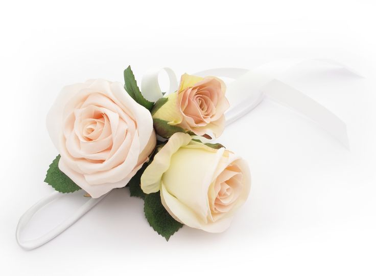 A cream/pink garden roses wristlet. Find your perfect wedding flowers at www.loveflowers.com.au