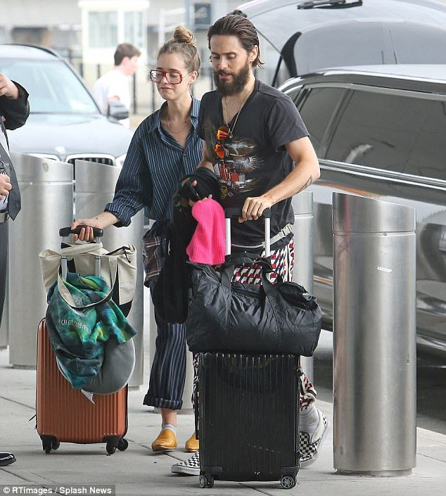 Had company: The actor was accompanied at the airport by his assistant Joie Estrella.